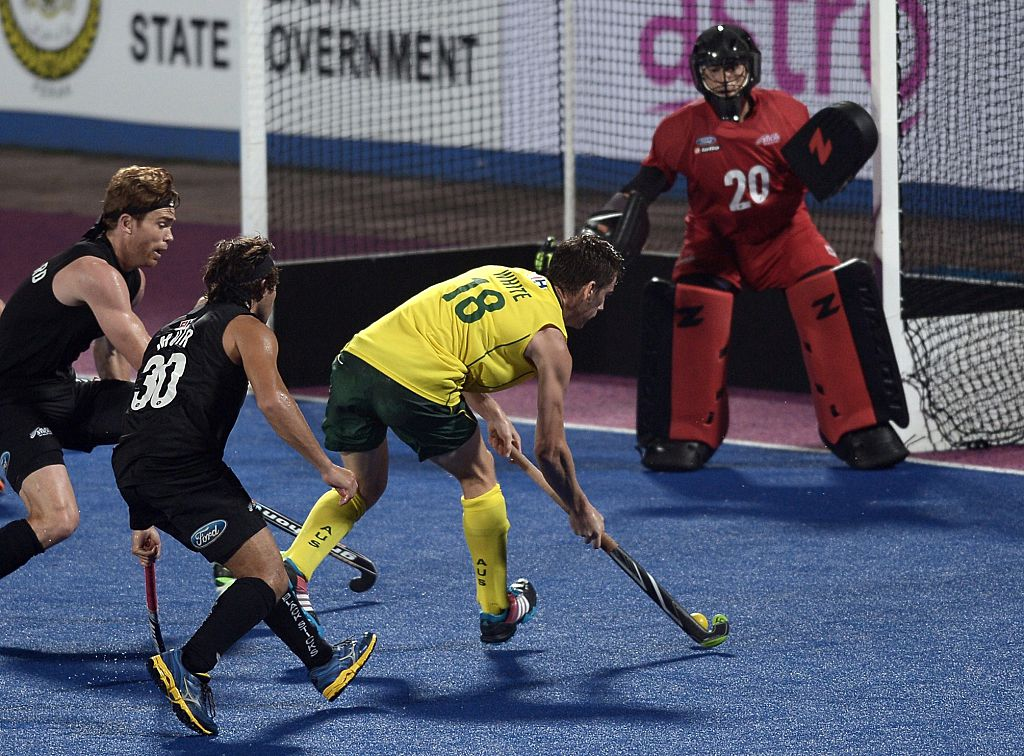 Australia's Tristan White (R) vies for the ball against New Zealand players during the Sultan Azlan Shah Cup