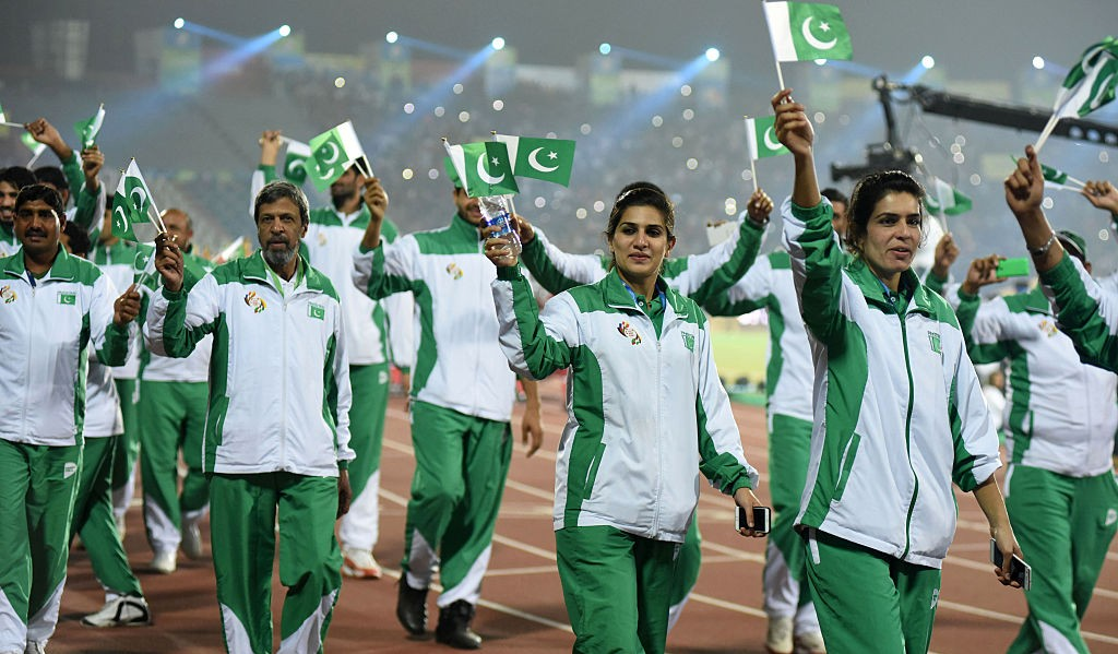 Athletes from Pakistan wave as they take part in the closing ceremony for the 12th South Asian Games