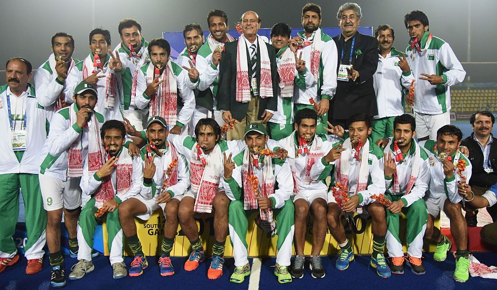 Pakistani hockey players pose for a photograph after winning the final against India at the 12th South Asian Games 2016