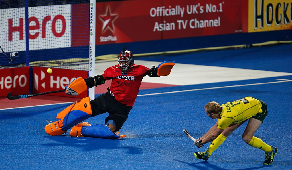 Aran Zalewski of Australia takes a penalty against goalkeeper Harmanpreet Singh of India during a shootout of the FIH Men's Hero Hockey Champions Trophy 2016 (Getty Images)
