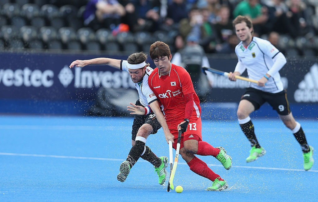 Martin Zwicker of Germany and Juhun Kim of Korea during the FIH Mens Hero Hockey Champions Trophy match between Korea and Germany