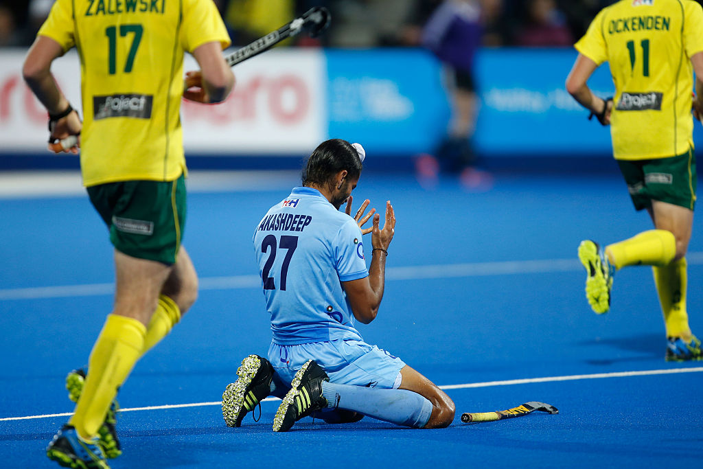 Akashdeep Singh of India kneels on the turf after missing a chance during the FIH Men's Hero Hockey Champions Trophy 2016 final between Australia and India